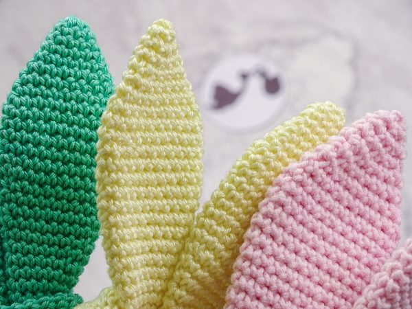 baby teethers in different colors bunny ears close shot