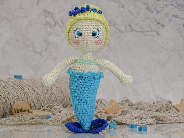 little mermaid with a blue starfish and golden hair