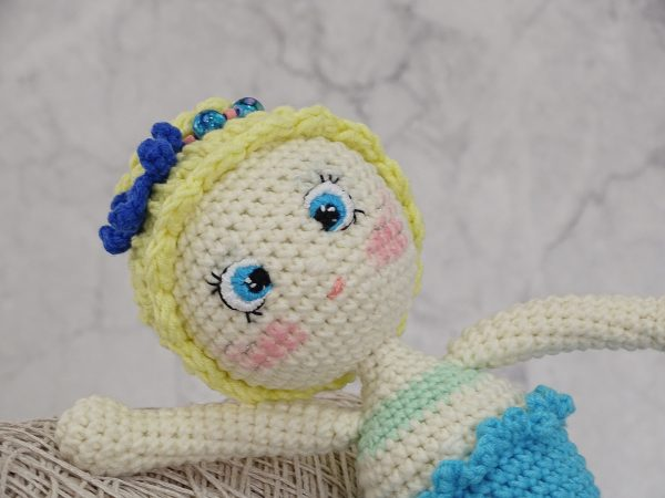 little mermaid with a starfish and beautiful sea beads close shot