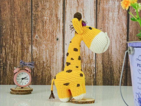 sweet lady giraffe with purple ribbon and long neck