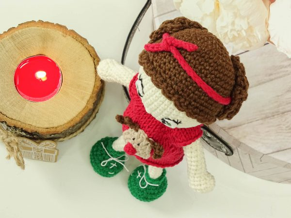 """christmas """"flower""""doll next to warm candle"""